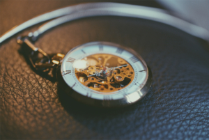 Picture of a gold and white pocket watch