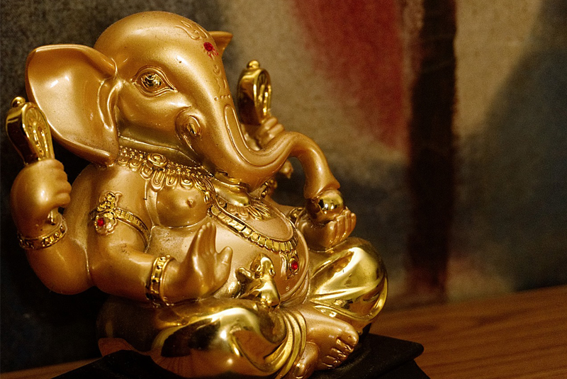 Picture of a golden idol of a Hindu god