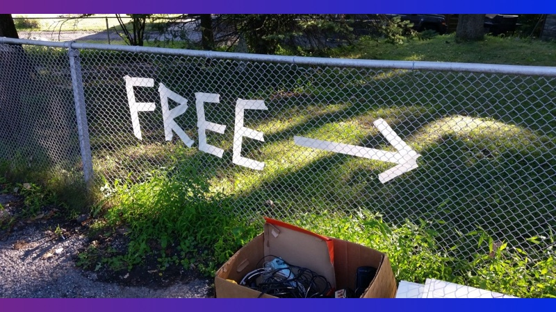 """Picture of a """"free"""" sign at a garage sale"""