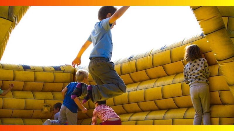 Kids jumping inside a bounce castle