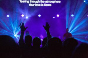 People lifting up their hands during a worship service
