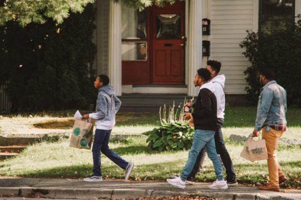 4 teenage boys walking down a sidewalk at Dare 2 Share LIVE