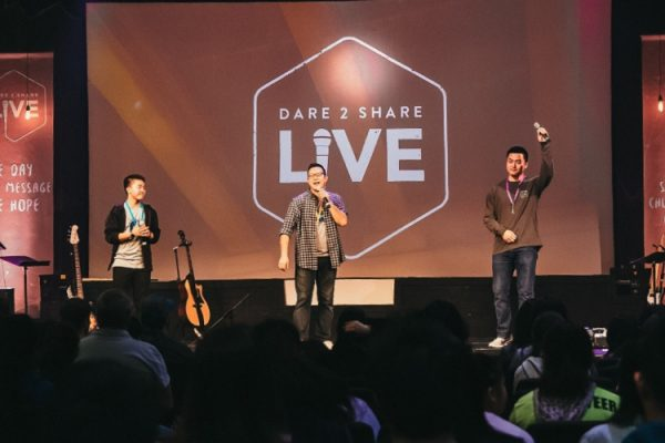 Image of three men on stage at a Youth Evangelism Conference called Dare 2 Share Live. This image represents Dare 2 Share Live Event Updates.